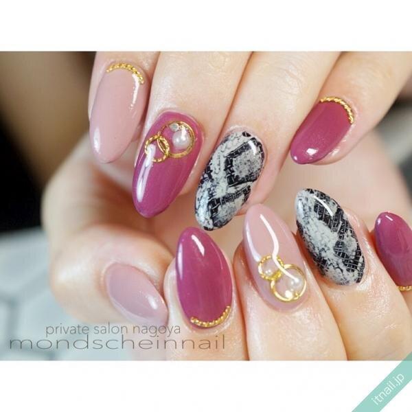 パイソン柄とピンクのネイル